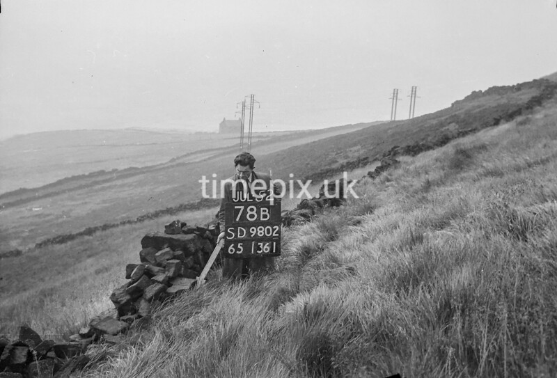 SD980278B, Man marking Ordnance Survey minor control revision point with an arrow in 1950s
