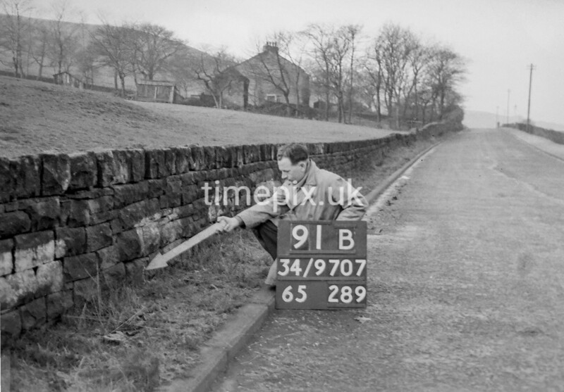 SD970791B, Man marking Ordnance Survey minor control revision point with an arrow in 1950s