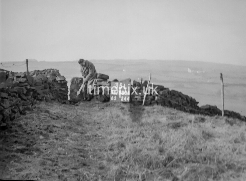 SD980635L, Man marking Ordnance Survey minor control revision point with an arrow in 1950s