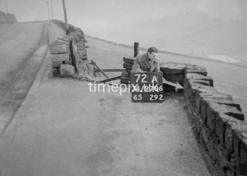 SD970672A, Man marking Ordnance Survey minor control revision point with an arrow in 1950s