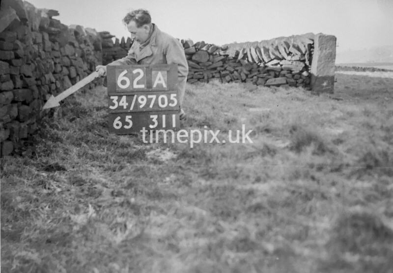 SD970562A2, Man marking Ordnance Survey minor control revision point with an arrow in 1950s
