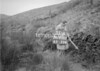 SD970731A, Man marking Ordnance Survey minor control revision point with an arrow in 1950s
