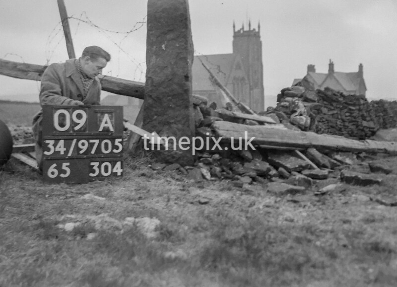 SD970509A, Man marking Ordnance Survey minor control revision point with an arrow in 1950s