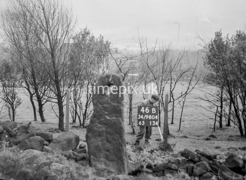SD980446B, Man marking Ordnance Survey minor control revision point with an arrow in 1950s
