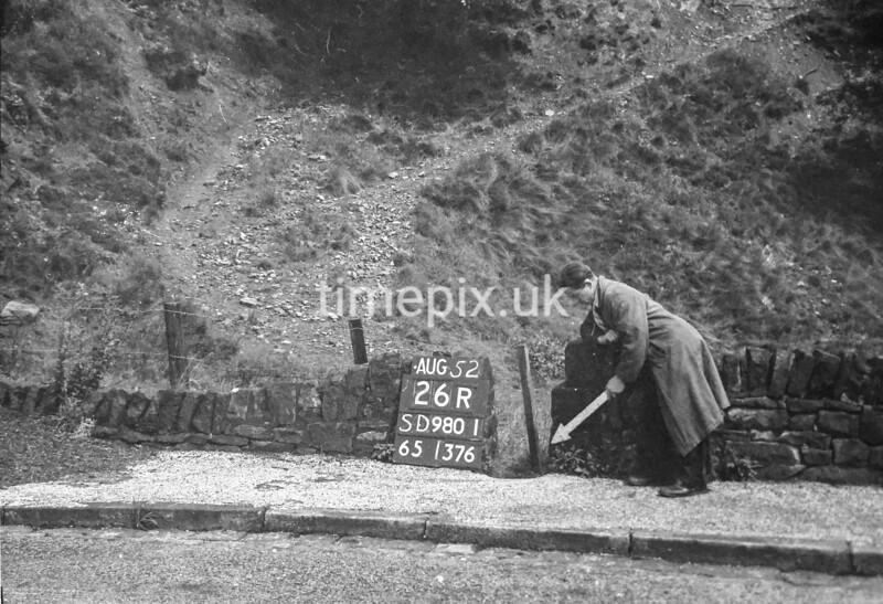 SD980126R, Man marking Ordnance Survey minor control revision point with an arrow in 1950s
