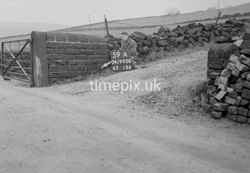 SD990859A2, Man marking Ordnance Survey minor control revision point with an arrow in 1950s