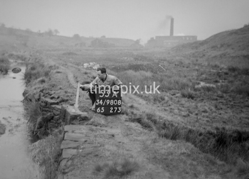 SD980853A, Man marking Ordnance Survey minor control revision point with an arrow in 1950s