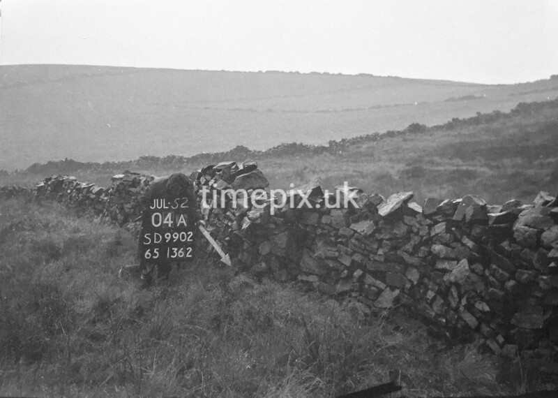 SD990204A, Man marking Ordnance Survey minor control revision point with an arrow in 1950s