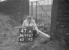 SD990747A, Man marking Ordnance Survey minor control revision point with an arrow in 1950s