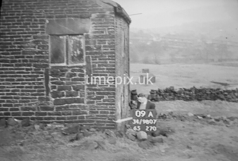 SD980709A, Man marking Ordnance Survey minor control revision point with an arrow in 1950s