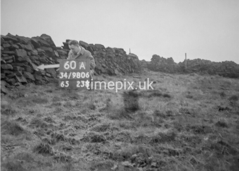 SD980660A, Man marking Ordnance Survey minor control revision point with an arrow in 1950s
