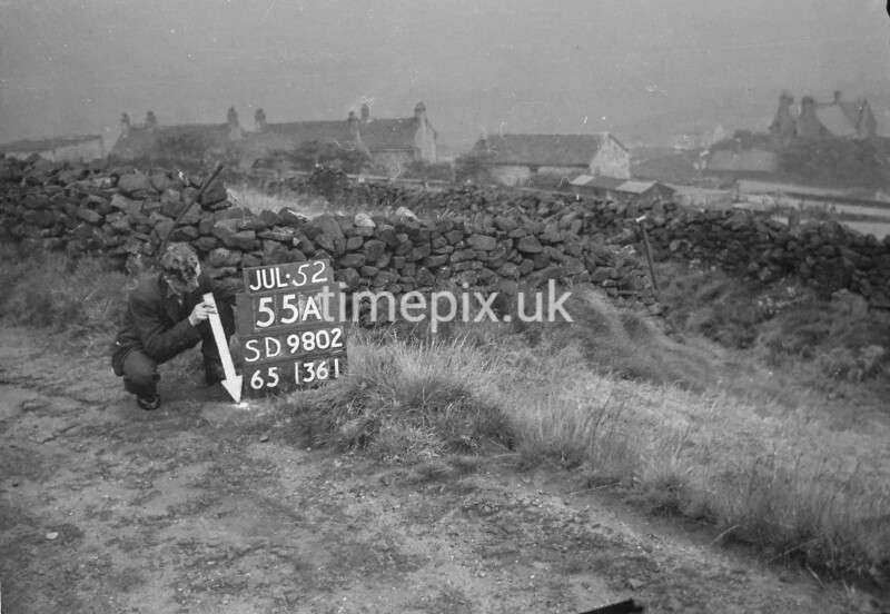 SD980255A, Man marking Ordnance Survey minor control revision point with an arrow in 1950s