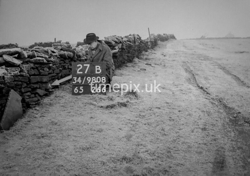 SD980827B, Man marking Ordnance Survey minor control revision point with an arrow in 1950s
