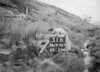SD970731B, Man marking Ordnance Survey minor control revision point with an arrow in 1950s