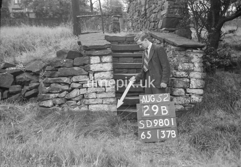 SD980129B, Man marking Ordnance Survey minor control revision point with an arrow in 1950s
