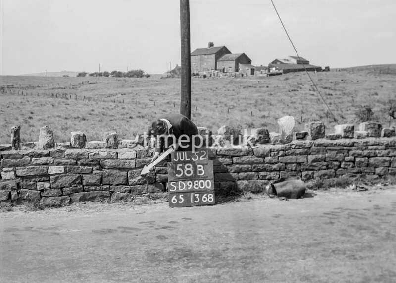 SD980058B, Man marking Ordnance Survey minor control revision point with an arrow in 1950s