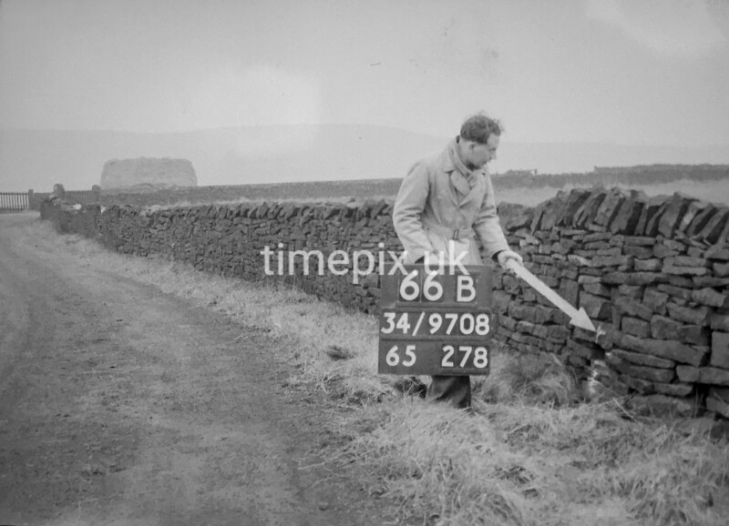 SD970866B, Man marking Ordnance Survey minor control revision point with an arrow in 1950s