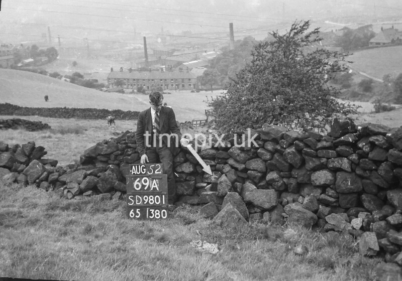 SD980169A, Man marking Ordnance Survey minor control revision point with an arrow in 1950s