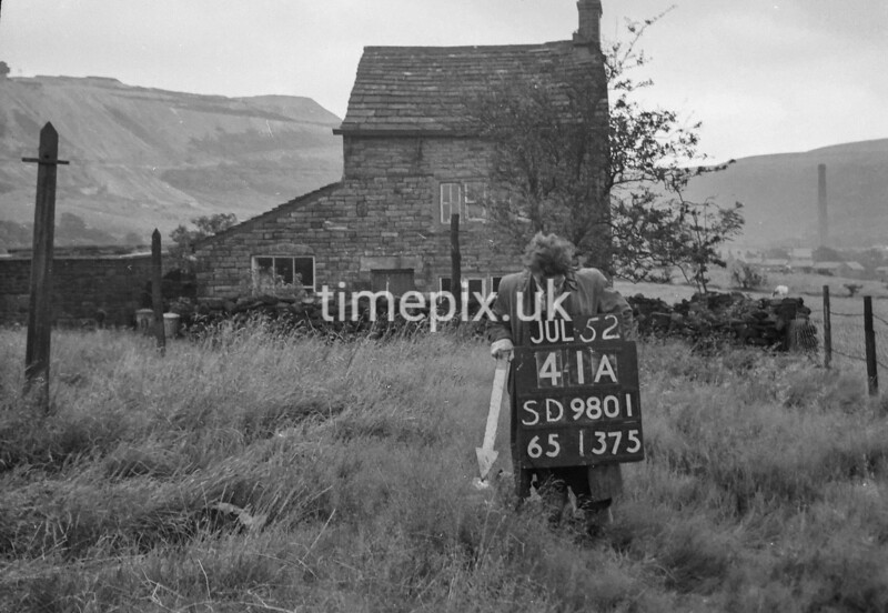 SD980141A, Man marking Ordnance Survey minor control revision point with an arrow in 1950s