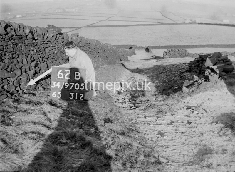 SD970562B2, Man marking Ordnance Survey minor control revision point with an arrow in 1950s