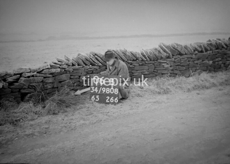 SD980806B, Man marking Ordnance Survey minor control revision point with an arrow in 1950s