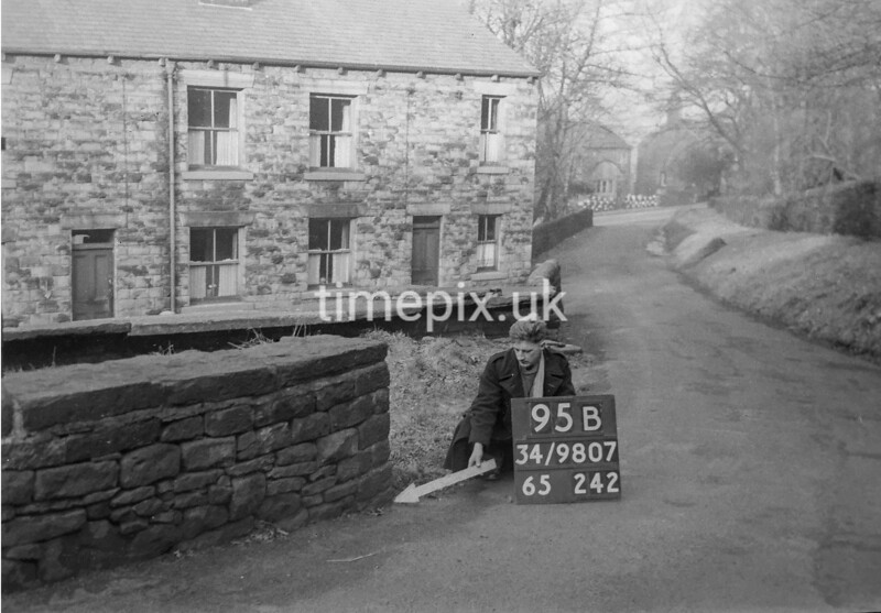 SD980795B, Man marking Ordnance Survey minor control revision point with an arrow in 1950s