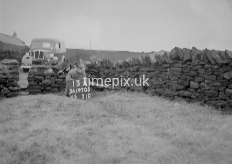 SD970513A, Man marking Ordnance Survey minor control revision point with an arrow in 1950s