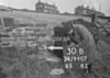 SD990730B, Man marking Ordnance Survey minor control revision point with an arrow in 1950s