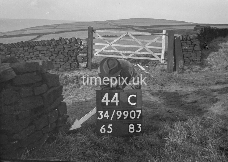 SD990744C, Man marking Ordnance Survey minor control revision point with an arrow in 1950s