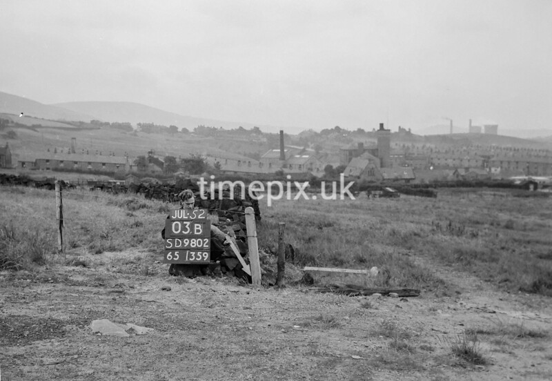 SD980203B1, Man marking Ordnance Survey minor control revision point with an arrow in 1950s