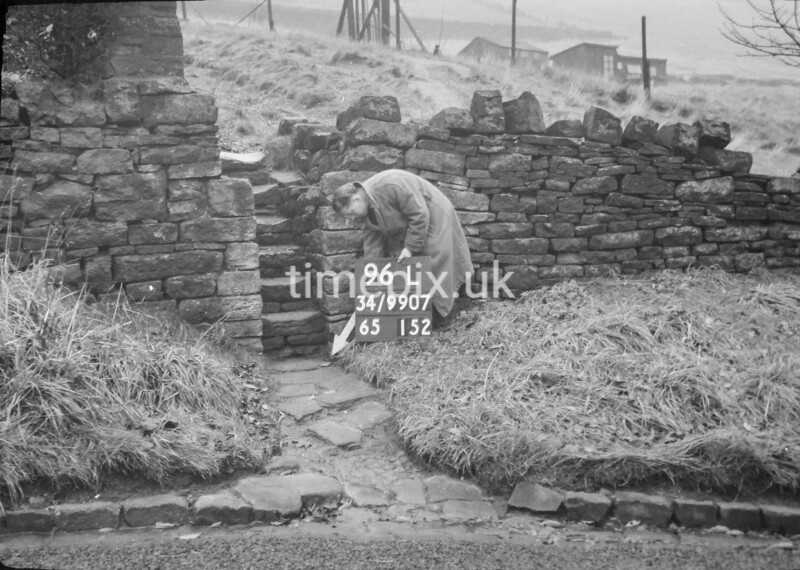 SD990796L, Man marking Ordnance Survey minor control revision point with an arrow in 1950s