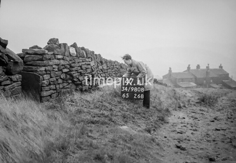 SD980847A, Man marking Ordnance Survey minor control revision point with an arrow in 1950s