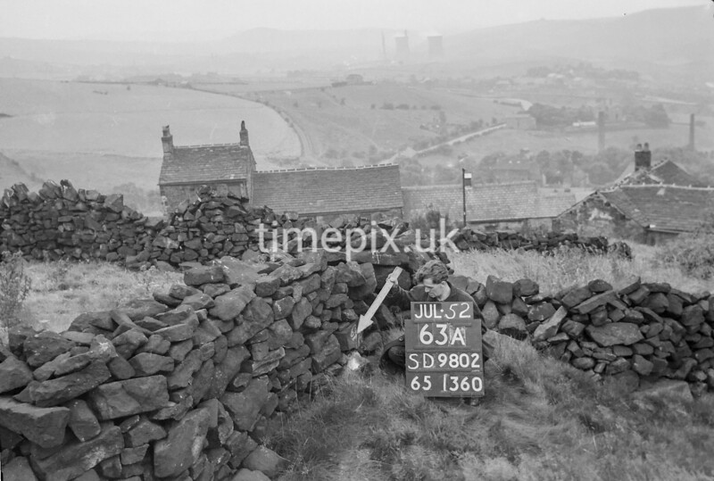SD980263A, Man marking Ordnance Survey minor control revision point with an arrow in 1950s