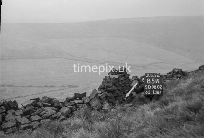 SD980285A, Man marking Ordnance Survey minor control revision point with an arrow in 1950s