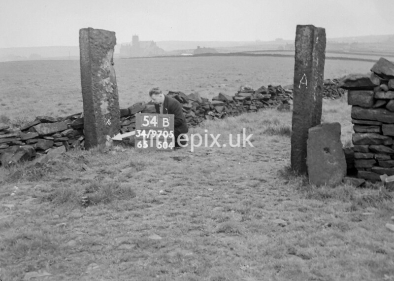 SD970554B1, Man marking Ordnance Survey minor control revision point with an arrow in 1950s