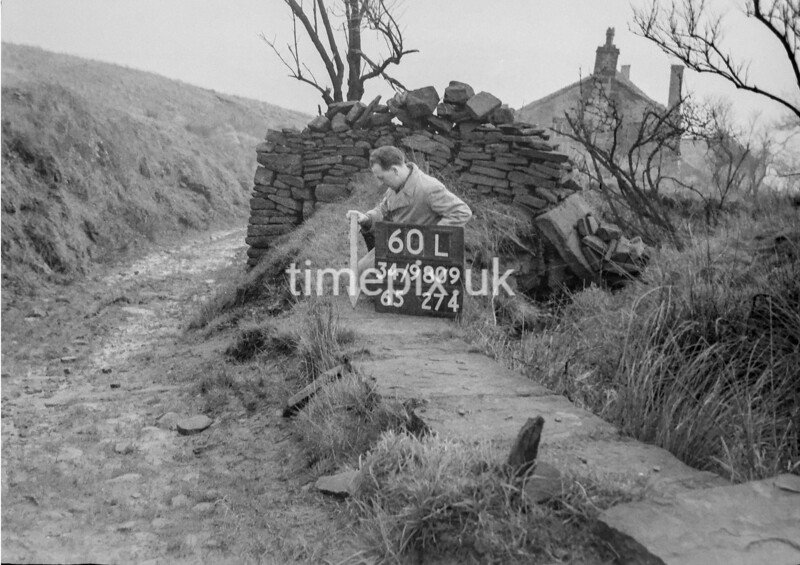 SD980960L, Man marking Ordnance Survey minor control revision point with an arrow in 1950s