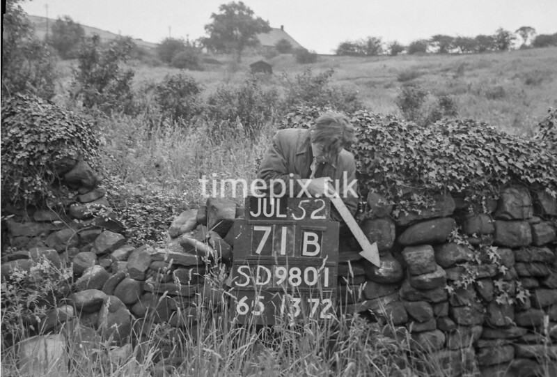 SD980171B, Man marking Ordnance Survey minor control revision point with an arrow in 1950s