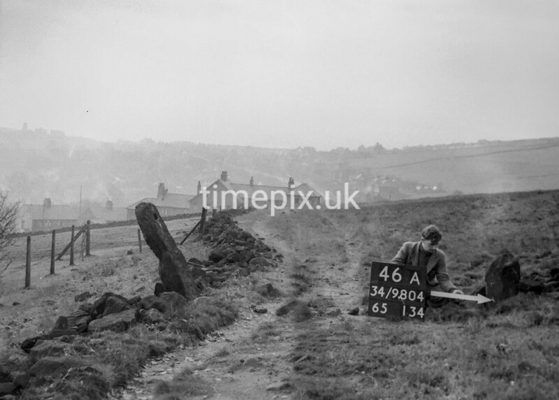 SD980446A, Man marking Ordnance Survey minor control revision point with an arrow in 1950s