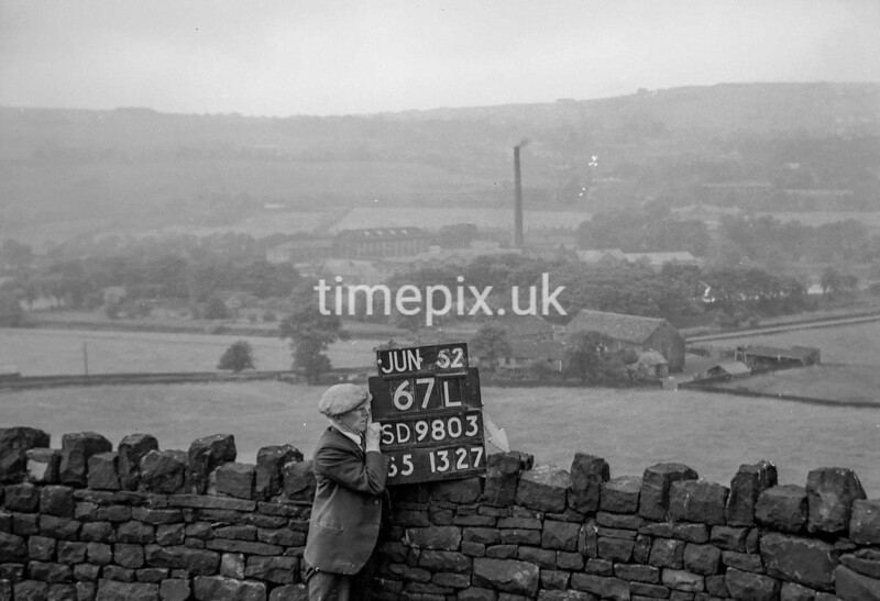 SD980367L, Man marking Ordnance Survey minor control revision point with an arrow in 1950s