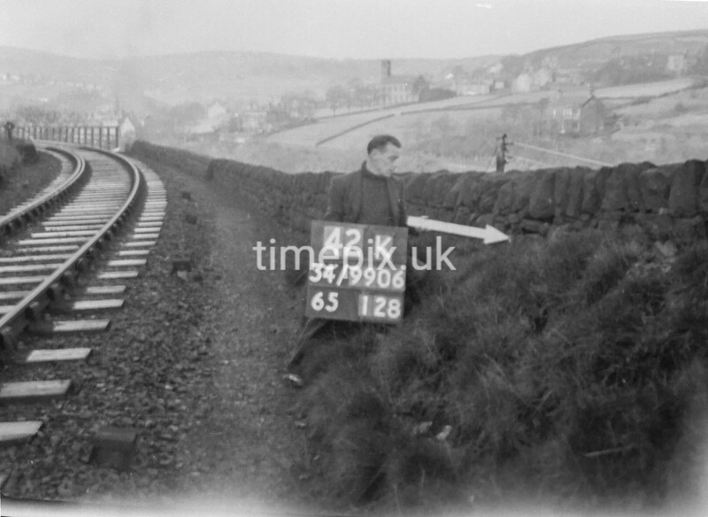 SD990642K1, Man marking Ordnance Survey minor control revision point with an arrow in 1950s