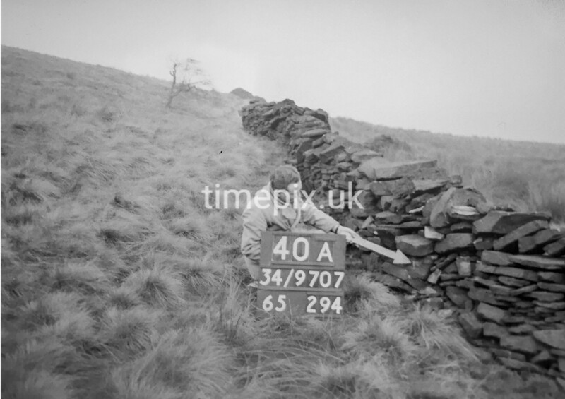SD970740A, Man marking Ordnance Survey minor control revision point with an arrow in 1950s