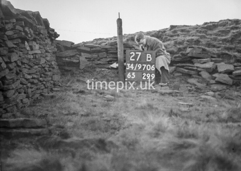SD970627B, Man marking Ordnance Survey minor control revision point with an arrow in 1950s