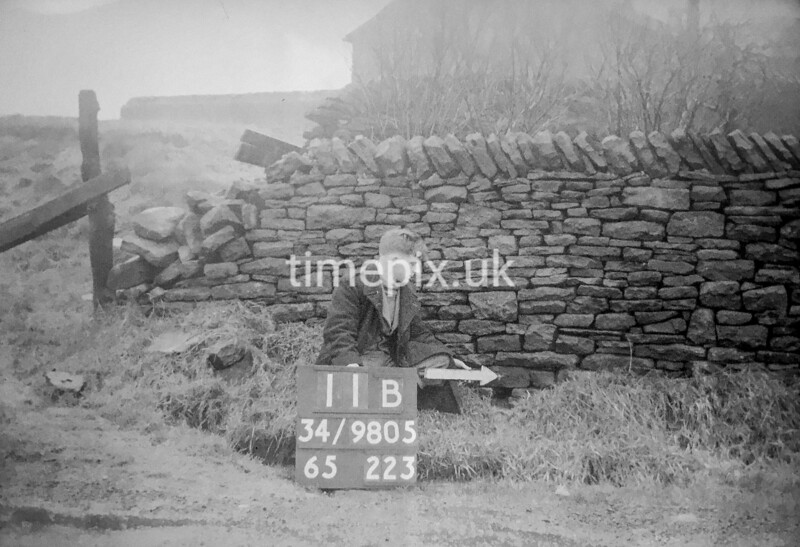 SD980511B, Man marking Ordnance Survey minor control revision point with an arrow in 1950s