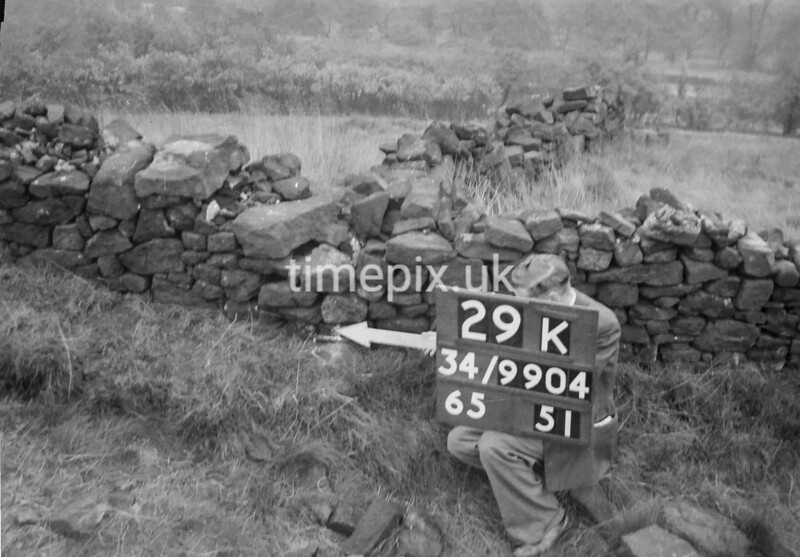 SD990429K, Man marking Ordnance Survey minor control revision point with an arrow in 1950s
