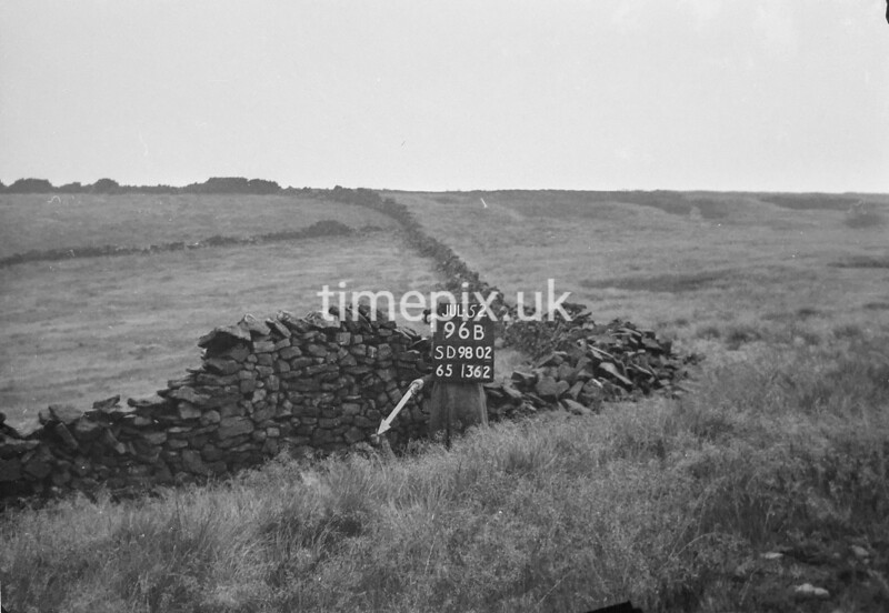 SD980296B, Man marking Ordnance Survey minor control revision point with an arrow in 1950s
