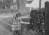 SD990744B, Man marking Ordnance Survey minor control revision point with an arrow in 1950s