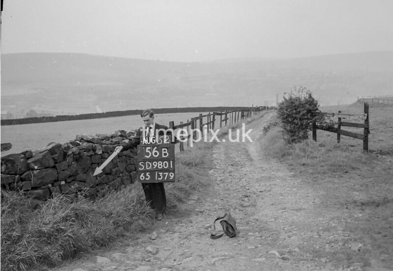SD980156B, Man marking Ordnance Survey minor control revision point with an arrow in 1950s