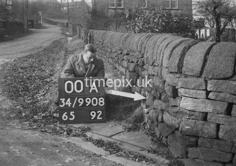 SD980800A, Man marking Ordnance Survey minor control revision point with an arrow in 1950s