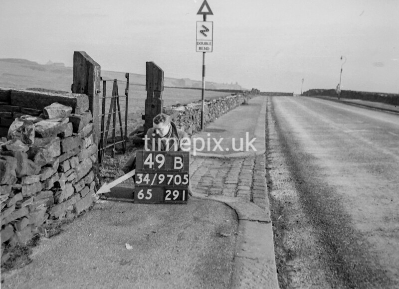 SD970549B, Man marking Ordnance Survey minor control revision point with an arrow in 1950s