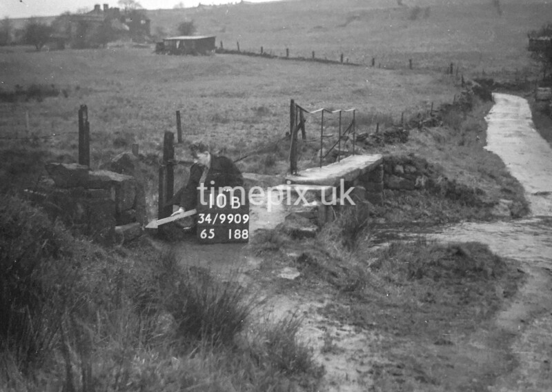 SD990910B, Man marking Ordnance Survey minor control revision point with an arrow in 1950s